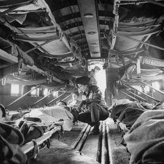 "American ""Flying Nurse"", Julia Corinne Riley, Checks on Patients Aboard C-47 Transport Plane"