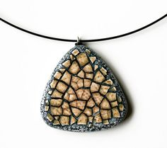 "Saw a demo of this technique by Diane Fulkenhagen at Yuma Symposium.""This piece is a triangular pendant with rounded edges that I made by combining the traditional Eggshell Mosaic technique with polymer clay. Shell Jewelry, Jewelry Box, Jewelery, Polymer Clay Pendant, Polymer Clay Jewelry, Eggshell Mosaic, Mosaic Rocks, Diy Crafts For Gifts, Egg Shells"
