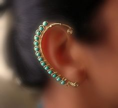 This ear-wrap made out of yellow brass wire and robins egg blue stabilized turquoise. You don't need any piercings to wear this piece; all you have to do is slide it on.