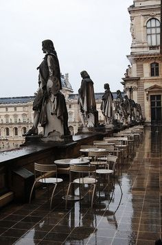 Musée du Louvre in Paris, France show this view of the elegant statues of people looking out upon the city from the restaurant patio deck. Notice the lovely reflections of the statues and building, reflecting off the wet rain-soaked floor. Paris Travel, France Travel, Paris France, Paris Paris, Places To Travel, Places To See, Jardin Des Tuileries, Louvre Paris, Ville France
