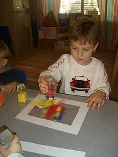 colored sand on contact paper = cool toddler craft!