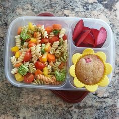 What's for lunch: veggie pasta salad (tomatoes, carrots, yellow bell pepper, broccoli and pasta mixed with Italian dressing), plums and a homemade strawberry rhubarb muffin.