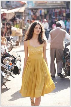 this flowy dress would be so fun to shoot in golden light // yellow spiced sundress • Anthropologie