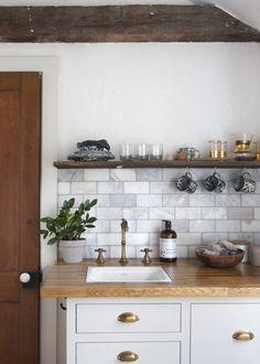 butcher block counter / brass drawer pulls / rustic modern kitchen