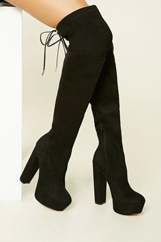 A pair of over-the-knee faux suede boots from LFL by Lust For Life™ featuring a platform, round toe, zipper side, block heel, and a faux leather drawstring top.