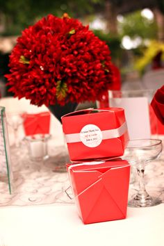 Short Table decor and wedding favors in red chinese take out boxes w/ charcoal/silver ribbon. Inside is delicious white chocolate popcorn! :)