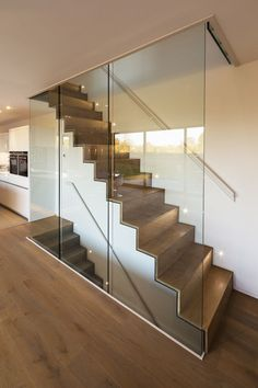 The home's ground level features engineered oak flooring. The staircase, which leads to the house's upper and lower levels, was constructed out of steel folded plate and subsequently clad in timber.