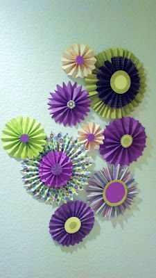DIY  Paper Flowers ...great idea for your Dorm Room to give it color and design.  www.dormdecorideas.blogspot.com