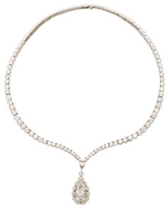 """Van Cleef & Arpels Riviere Diamond Platinum Link Necklace with 104 round brilliant cut diamonds and 1 pear-shape diamond. Diamond total weight - 25ct approximately, color: F-G, clarity VS, center stone pear brilliant cut diamond, 5.01 ct color G, clarity VS1, certified. Signed """"Van Cleef & Arpels N.Y. 26836"""". French, circa 1960. Via 1stdibs."""
