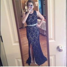 Prom/Pageant Navy Lace Dress with Silver Beading I wore this once for prom! It is hemmed for someone who is 5'2 to 4'9! I am pretty short so I always have to hem my dresses! But it's a beautiful dress and I love it so much! sadly ill never wear it again, so that is why I'm selling it! It has a nude slip so its not see through and its gorgeous on! Dillards Dresses