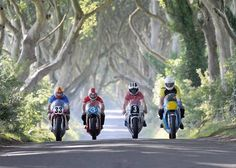The Armoy Armada pictured at the Dark Hedges near Armoy. A group of four local Racers from Armoy, Co.Antrim who dominated motorbike road racing for a period during the 1970's. The group included the world famous, Joey Dunlop. This group's racing skills have since drawn thousands of roadrace fans from all over the world to the North West 200 race at Portrush.
