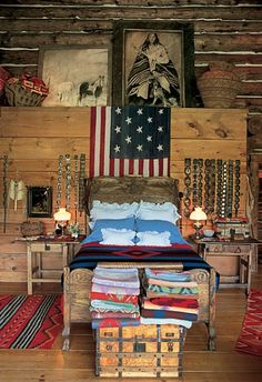 Main Lodge    In the master bedroom, concho belts and an Indian chief blanket with an American flag motif, both 1880s, hang on a ledge holding an Apache olla basket, at right. The 19th-century breastplate with mirror, at left, is believed to have come from the Blackfoot Indian tribe.