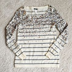J. Crew Merino Confetti Stripe Sweater - Silver Gorgeous sequin stripe sweater. Silver version, also have blue sequin version listed as well. Excellent condition, just one minor barely noticeable stain on sleeve. Difficult to even photograph. No pilling at all. Merino wool. Size XS. -------- The new way to wear sequins: sprinkled over a mariner's stripe. A mix of shiny and matte sequins on our classic merino boatneck make this sweater destined to become your favorite. In a 14-gauge knit…