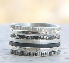 Skinny stacking rings set of 7 - Hammerd ,black oxidation,  polished silver bands.