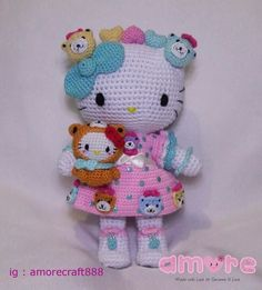 Amigurumi hello kitty Mimmy and Hello kitty dress as tiny chum
