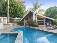 This mid-century modern home features both a pool, spa and landscaped gardens. 11228 W. Sunset Blvd | Westwood Hills