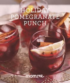 Christmas Pomegranate Punch Recipe: This festive holiday drink blends rum with pomegranate juice and hibiscus tea! It tastes like German mulled wine, but is served chilled, and it's positively delicious.