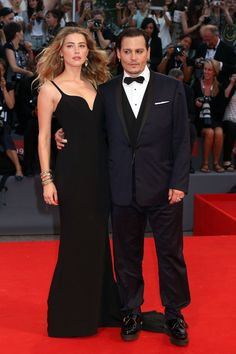 Pin for Later: See All the Best Dressed Stars at the Venice Film Festival Amber Heard and Johnny Depp The couple were the perfect match at the Black Mass premiere. Amber wore a strappy black Stella McCartney gown.