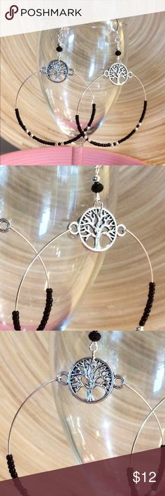 Tree of life hoop earrings These are made with 925 Sterling silver ear wires and plastic earring stoppers. They hang 3 inches. Black glass beads and silver plated balls. Silver alloy detailed tree of life. Handmade by me Jewelry Earrings