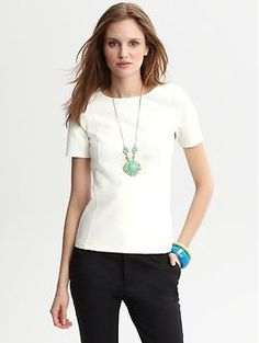 A white top in thick material--this might be exactly what I've been looking for (Banana Republic Pia white ponte knit tee).