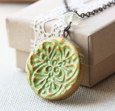 Tamar Necklace- round green and gold pendnant. $24.00, via Etsy.