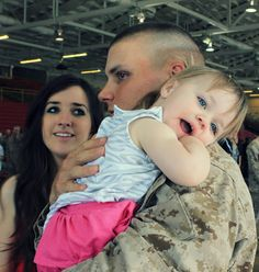 Happy Memorial Day! This is such a beautiful picture- this was the first time in 3 months that this one year old little girl saw her US Marine daddy. She looks so happy! God Bless America! <3