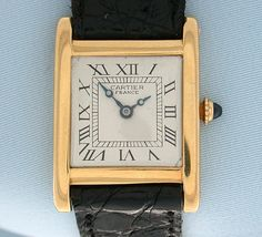 Cartier - Manual Tank Wrist Watch. 18 Karat Yellow Gold with Sapphire Crown and Leather Strap with Deployment Buckle. France. Circa 1930.
