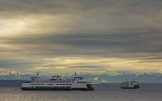 The ferry Issaquah, left, coming from Vashon Island, heads towards the Fauntleroy dock in West Seattle while the ferry Kitsap heads toward Southworth on Monday, Jan. (Ellen M. Banner/The Seattle Times)