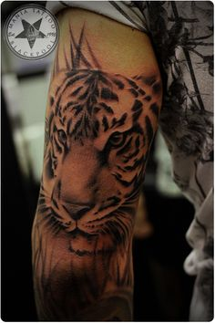 658e4b36e Mania Tattoo Blackpool. See more. Tiger tattoo done on the tricep of a  strapping young lad in black and grey.