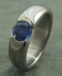 Eye of the Beholder 1/2 Carat Blue Sapphire Tension Engagement Ring     The Eye of the Beholder 1/2 Carat Blue Sapphire Tension Engagement Ring certainly shows the beauty of this timeless creation is
