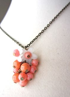 Spring Flowers in resin and coral, resonate throughout the summer and fall.