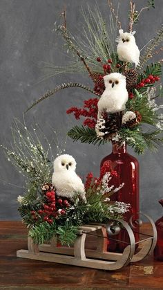 Decorating with RAZ White Feathered Owls .  Love the owls