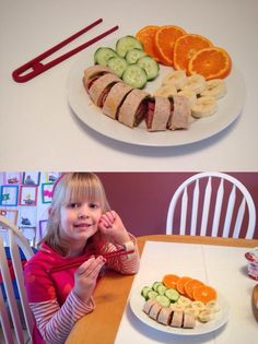 Fun kids meal - salami sushi (salami, hummus, spinach, and wheat tortilla), orange slices and cucumbers.