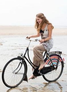 Dutch 'Dress guard': oilcloth or plastic lining partially surrounding the rear wheel of a bicycle, to prevent a long coat or skirt from coming into contact with the wheel. Nowhere else in the world are dress guards so common... The dress guard may be regarded as a unexpected symbol of women's emancipation, where professional women and others dressed in skirts or long coats can ride without worry.