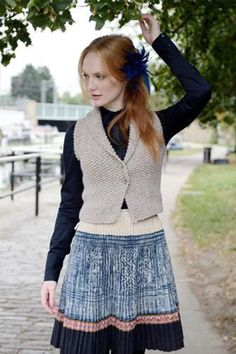 As a beginner, making the step from knitting small accessories to making your first ever garment can seem daunting. The Iago waistcoat would be the ideal place to start! The waistcoat is knitted completely without shaping and with only three seams. Can't get much easier than that! The variations in stitch texture using different combinations of knit and purl makes this a high end fashion item anyone would be proud to wear. Tension: 16 sts and 23 rows to 10 cm square over Stocking Stitch…