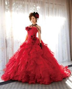This is a bit over the top for my taste, and I would never wear and all red dress for my wedding, but I thought it was kinda pretty, so I figured I'd pin it anyway! ;) <3