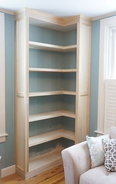 DIY: How to Build a DIY: How to Build a Corner Bookcase - this is a great way to add storage to an odd corner of a room - via Year of Serendipity