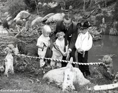 """On May 28, 1960, Walt Disney & his grandchildren christened the new scenery of the Nature's Wonderland attraction, which now had 204 """"lifelike"""" animals. This photo shows Walt with his grandchildren Tammy, Joanna, and Chris Miller at the branch cutting ceremony."""