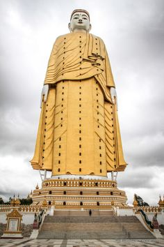 The Laykyun Setkyar, a standing Buddha statue on a 44 ft (13.5 m) throne, Khatakan Taung, Myanmar. Built by Chief Abbot Ven. Nãradã, constructed between 1996 and 2008. The statue has a height of 381 ft (116 m).