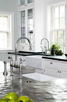 Love the black soapstone with hammered stainless steel countertops--great hi-arc fixtures, too! - Opal Design Group