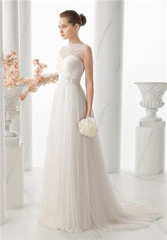 Alma Novia - A stunning wedding dress with a ruched, sweetheart bodice, Naiara uses a medallion-inspired lace to overlay the skin of the chest and back. Beading at the natural waistline and a softly pleated skirt are details that add to the gown's femininity.