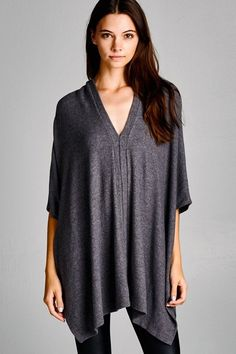 Oversized v-neck sweater, with a soft texture and a bit of stretch Model is wearing a small 21% polyester 74% rayon 5% spandex