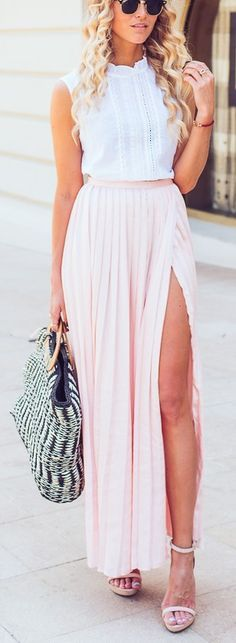 Feminine in ruffles and pleats. I love this pink maxi skirt with its thigh-high slit.