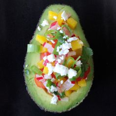 Stuff your avocado with a crisp and colorful chopped produce.