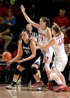 Colorado forward Zoe Beard-Fails (31) is guarded by Stanford forward Bonnie Samuelson (41) and guard Karlie Samuelson (44)