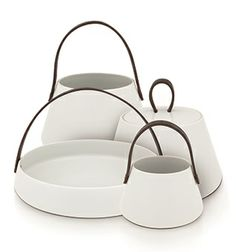 Jardinière is a collection of decorative porcelain baskets with leather handles.