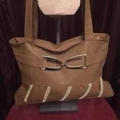 ⬇️Price Drop!⬇️ Brown and silver handbag Cute faux leather brown handbag with silver sparkly details. Brand new without tags, never used it. Not sure of the brand, just a cute little fashion bag:) no trades make an offer!✅ oh & follow me on Instagram @BeThriftyChic  Charming Charlie Bags Shoulder Bags