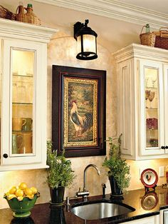 An exterior lantern adds a decorative touch to the wall, shedding light on the sink and highlighting the artwork below. Home-improvement stores carry various styles of lights for less than $50. (Photo: Photo: Jean Allsopp; Stylist: Lisa Powell)