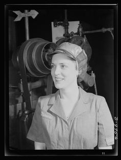 Caption (Original Description) Safe clothes for women war workers. Her hair tucked away under a safety cap, war worker Eunice Kimball stands beside whirling machine wheels with no wisp of hair exposed. She's completely protected from the danger of entanglement in moving machine parts. Bendix Aviation Plant, Brooklyn, New York Photographer Ann Rosener Created March 1943