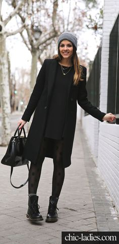 Winter Outfits We'd Wear: Natalia Cabezas is wearing a black dress and coat from Zara, boots from Dr. Martens